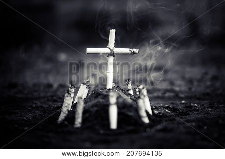 A Cemetery With A Grave Made Of Cigarettes