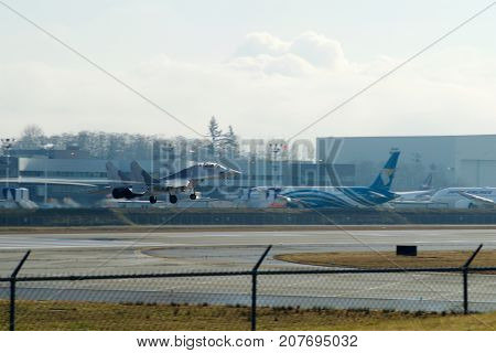 EVERETT, WASHINGTON, USA - JAN 26th, 2017: A MiG-29UB during a low pass athe Boeing factory site at Snohomish County Airport or Paine Field.