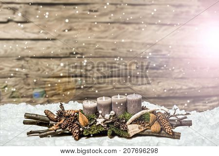Merry Christmas decoration advent with burning grey candle Blurred background snow text space message 3rd