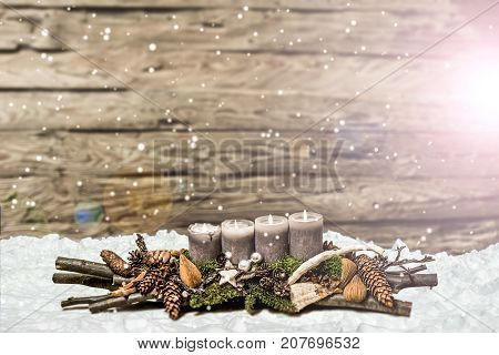 Merry Christmas decoration advent with burning grey candle Blurred background snow text space message 4th