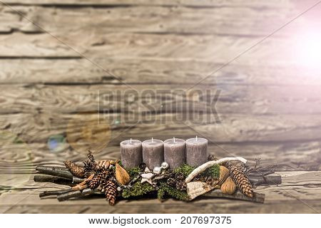 Merry Christmas decoration advent with burning grey candle Blurred background text space message