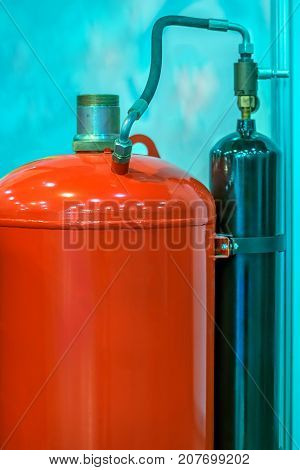 Flammable gas cylinders with hoses and reducers