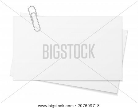 Paper sheet and paper clip on a white background.