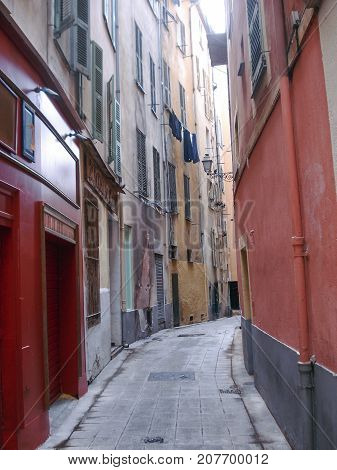 Traditional alley in Nice, France with washing hanging from an upper window