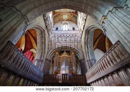 St Davids, Pembrokeshire, UK: October 27, 2012: Impressive view of the main alter in St Davids Cathedral. The cathedral was founded by Saint David of Menevia who died in 589.