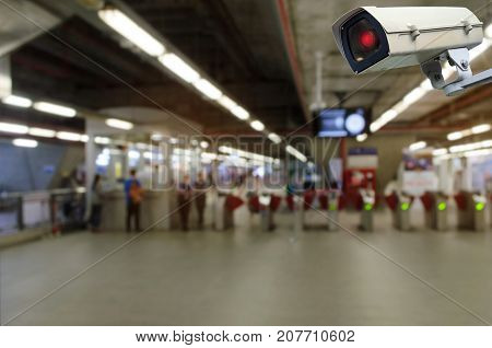 CCTV security indoor camera system operating with blurred image of entrance of subway or railway at train station transportation surveillance security and safety technology concept