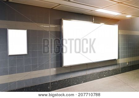 blank advertising billboard with copy space for your text message or media and content in subway train station or airport information board mock up banner marketing and advertising concept