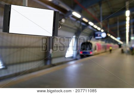 CCTV and LCD TV with white blank screen copy space for advertising or media and content marketing with blurred image of subway at train station transportation marketing and advertising concept