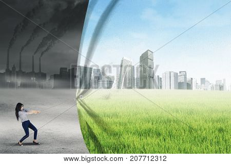 Concept of climate change. Young businesswoman changes environment from polluted city to be a green city