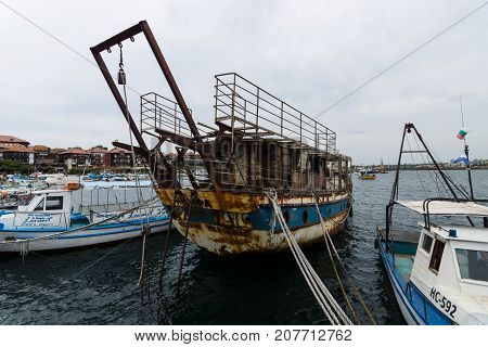 NESEBAR BULGARIA - AUGUST 21 2017: An old rusty and abandoned ship
