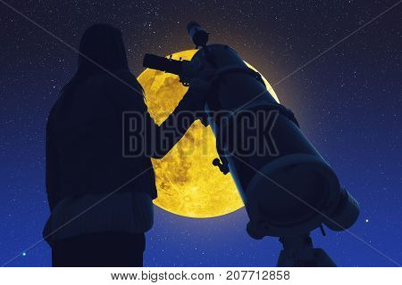 Girl looking at the stars and full Moon through a telescope.