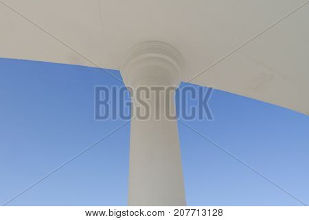 White column. Abstract image of the column. White column on a blue background. Column.