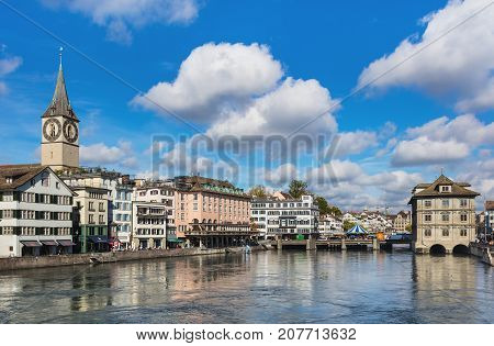 Zurich, Switzerland - 7 October, 2017: view along the Limmat river from Munsterbrucke bridge towards Rathausbrucke bridge. Zurich is the largest city in Switzerland and the capital of the Swiss canton of Zurich.