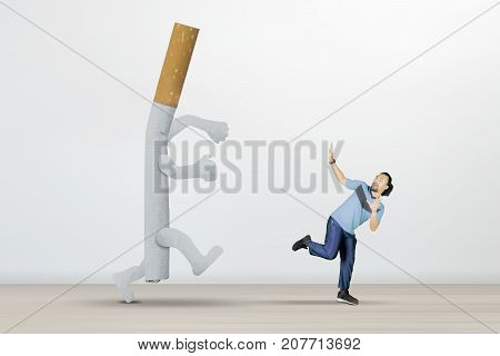 Picture of African man chased by a cigarette while running in the studio isolated on white background