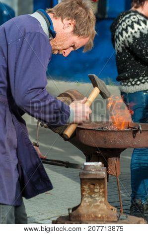 Blacksmith Heating The Iron