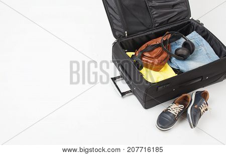 Open Suitcase With Men's Summer Things On A White Background