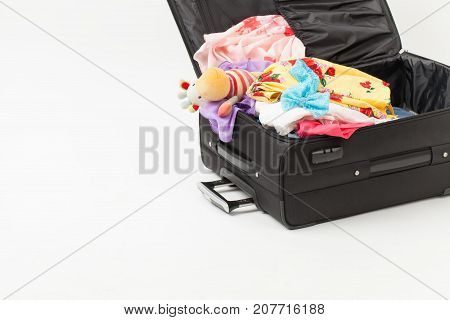 Things In Open Road Suitcase With A Children's Toy