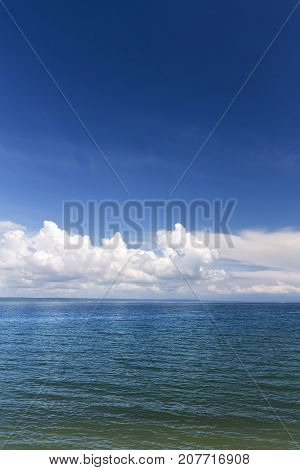 cloud over turquoise water / bright summer day in the wilderness