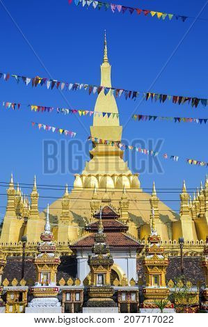That Luang Stupa, Landmark Of Vientiane, Lao Pdr, Decorated With Colourful Pennant Banners During An