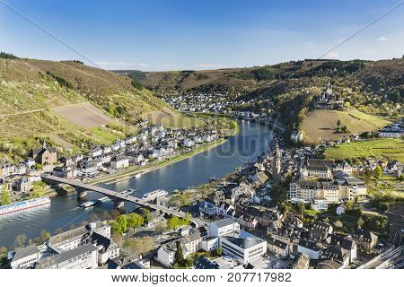View over the famous city of Cochem in the Eifel with the Moselle River valley in Germany and the Reichsburg Cochem to the right. poster