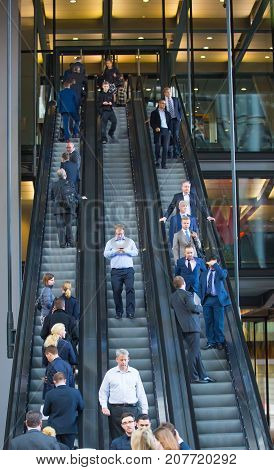 London, UK - March 15, 2017: City of London. Business people on the escalator.   Modern busy business life concept.