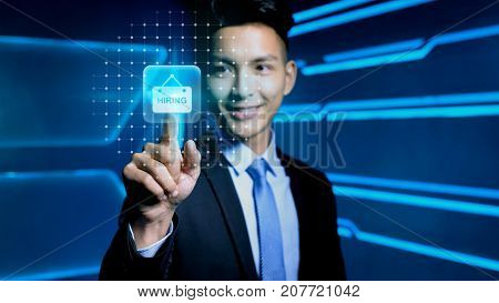 businessman touch hire icon on blue background