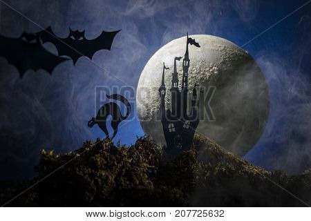 Night background of Halloween with bats flying in the moonlight