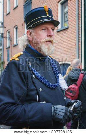 Deventer Netherlands - December 18 2016: Policeman one of the characters from the famous books of Dickens during the Dickens Festival in Deventer in The Netherlands