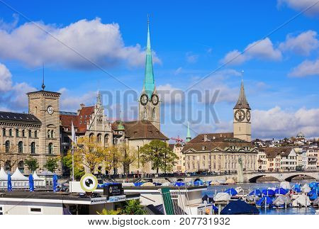 Zurich, Switzerland - 7 October, 2017: view from Limmatquai quay across the Limmat river with famous city landmarks: the City Hall, the Fraumunster Cathedral and the tower of the Saint Peter Church. Zurich is the largest city in Switzerland.