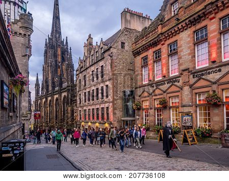 EDINBURGH, SCOTLAND - JULY 28: A ghost tour along the Royal Mile on July 28, 2017 in Edinburgh, Scotland. A popular activity for tourists is the evening ghost tours which wind through the old town.