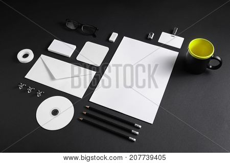 Blank corporate stationery template on black paper background. Mock up for placing your design.