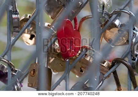 Shiny marriage padlocks after a rain. Good backround image for love, commitment, marriage.