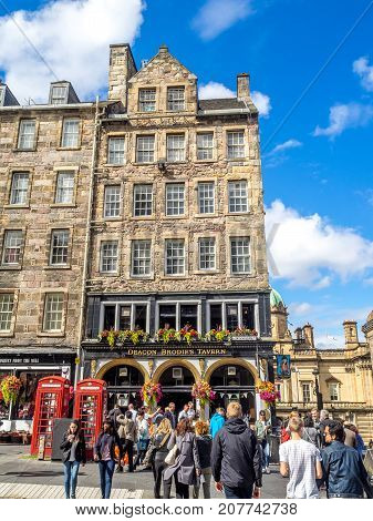 EDINBURGH, SCOTLAND - JULY 29: Deacon Brodie's Pub along the Royal Mile on July 29, 2017 in Edinburgh, Scotland. There are many such pubs on the Royal Mile serving tourists with whisky, beer, etc.