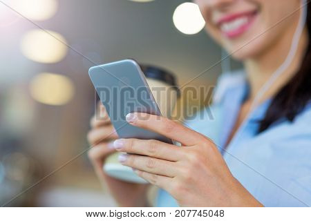 Woman with coffee and smart phone