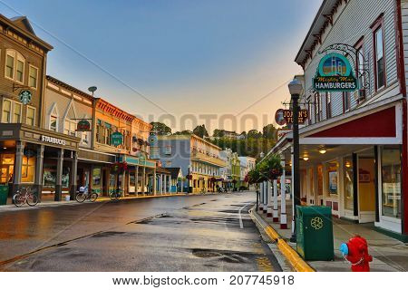MACKINAC ISLAND, MICHIGAN - SEPTEMBER 12, 2017:  The main street of Mackinac Island is full of quaint shops and restaurants.  This is a popular vacation destination in Michigan.