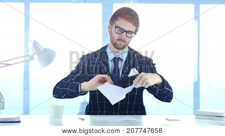 Angry Redhead Man Tearing Papers In Office, Fail Work