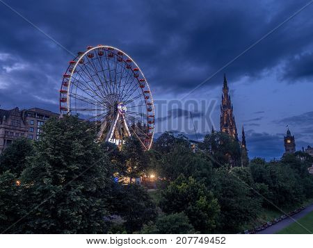 EDINBURGH, SCOTLAND - JULY 30: View of the Festival Wheel, a large and temporary mechanical Ferris Wheel, on July 30, 2017 in Edinburgh, Scotland. It is located in East Princes Street Garden.