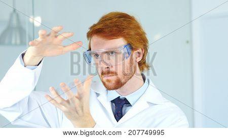 Research Scientist Imagining New Idea In Laboratory, Creative