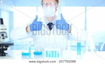 Thumbs Up by Redhead Scientist in Laboratory