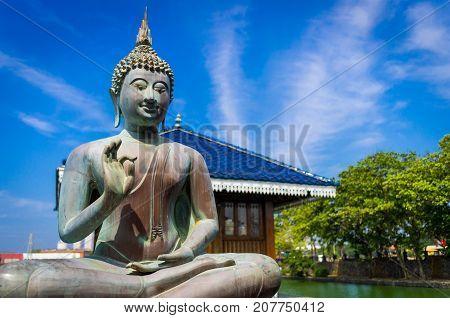 Blessing Buddha in Gangarama Buddhist Temple, Sri Lanka