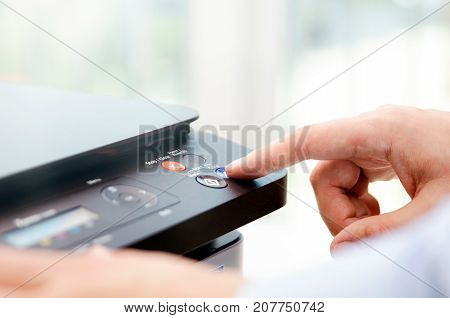 Hand Press Button On Panel Of Printer