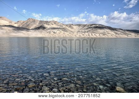 Bulunkou Lake, the reservoir, in Xinjiang Uighur Autonomous Region of China with Kunlun mountains, in the background.
