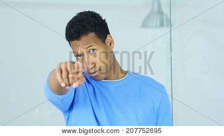 Young Afro-american Man Pointing Toward Camera With Finger