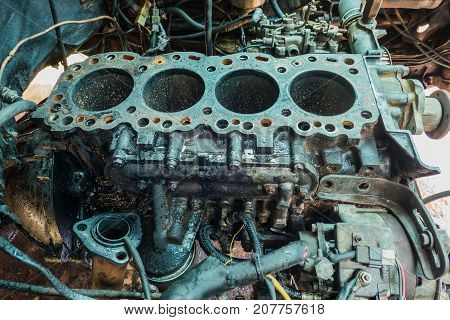 Disassembled car vehicle , four-cylinder engine for repair.