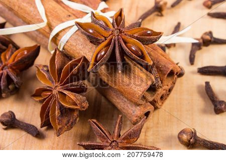Star Anise, Cinnamon Sticks And Cloves On Board, Seasoning For Cooking Or Baking