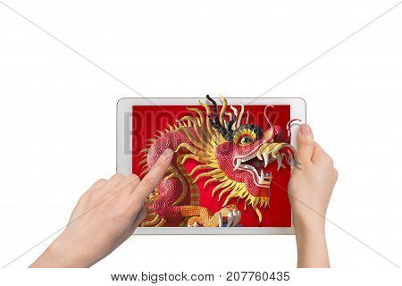 human hand hold smartphone tablet cell phone with big dragon statue come out screen. concept of celebrate Chinese New Year background concept of the Year of the Dragon.