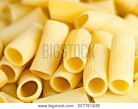 close up of uncooked italian rigatoni pasta