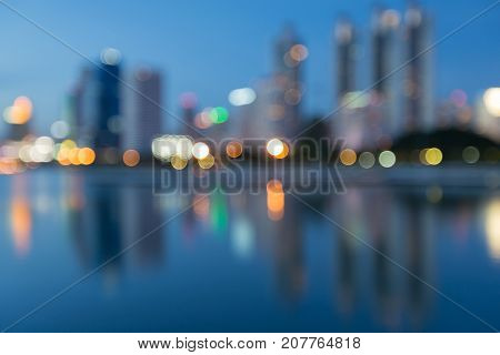 Blurred bokeh light blue twilight office building abstract background
