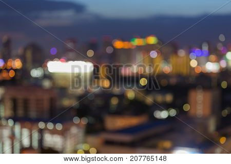 Blurred bokeh light office building downtown at twilight abstract background
