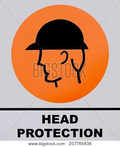 Photo of Head Protection sign on white and orange background.